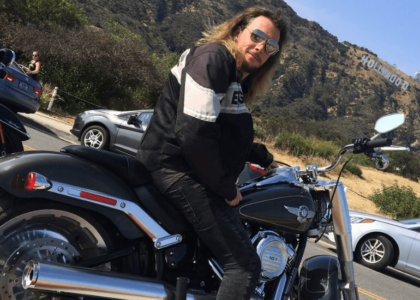 Harley Davidson Rental LA, Los Angeles 3 day Itinerary biker in front of hollywood sign